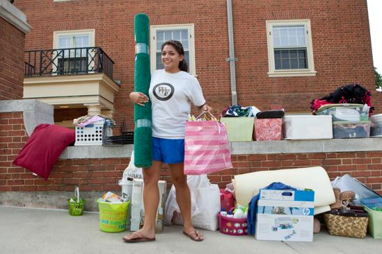 Wake Forest sophomore Gracie Zvara moves into Davis Residence Hall with help from her paretns, David and Bharathi Zvara, on Monday, August 18, 2008. Gracie is an orientation advisor.