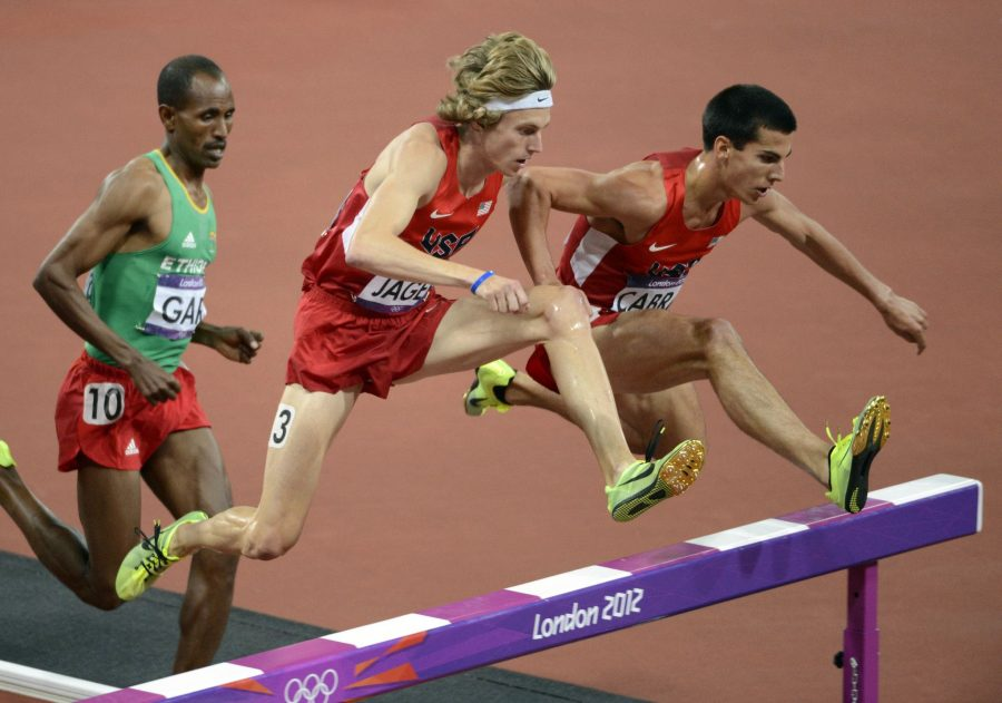 Donn Cabral of Glastonbury, right, competes in the 3,000-meter steeplechase at the London Olympics in 2012.