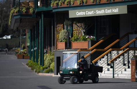 LONDON, ENGLAND - APRIL 01:  A member of staff works outside Centre Court at The All England Tennis and Croquet Club, best known as the venue for the Wimbledon Tennis Championships, on April 01, 2020 in London, England. The Coronavirus (COVID-19) pandemic has spread to many countries across the world, claiming over 40,000 lives and infecting hundreds of thousands more. (Alex Davidson/Getty Images/TNS)