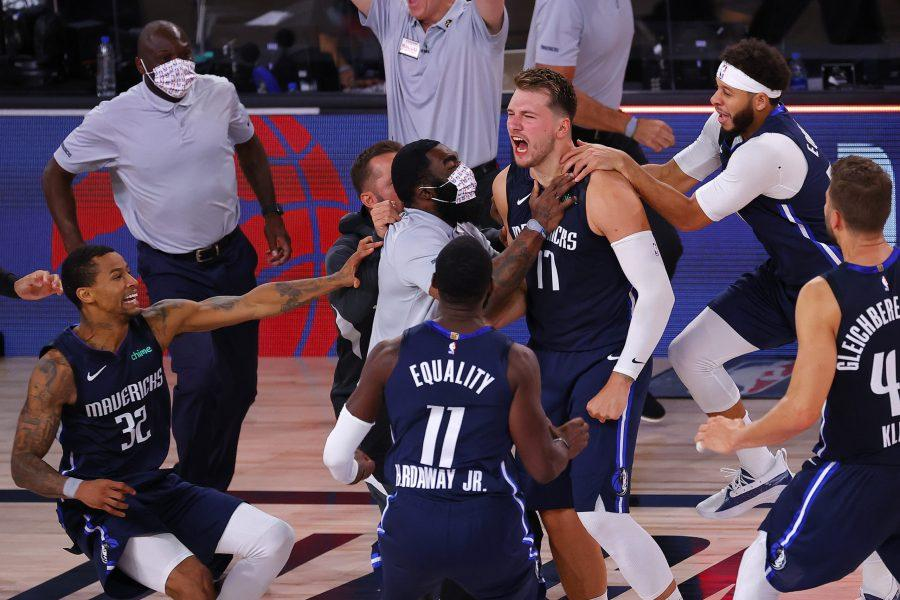 Luka+Doncic+%2877%29+of+the+Dallas+Mavericks+celebrates+a+game-winning+three-point+basket+with+teammates+against+the+Los+Angeles+Clippers+during+overtime+in+game+four+of+the+Western+Conference+First+Round+on+Sunday%2C+August+23%2C+2020+at+AdventHealth+Arena+at+ESPN+Wide+World+Of+Sports+Complex+in+Lake+Buena+Vista%2C+Florida.+%28Kevin+C.+Cox%2FGetty+Images%2FTNS%29