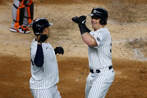 Luke Voit (59) of the New York Yankees celebrates with Gary Sanchez (24) after hitting his second 3-run home run of the game in the fifth inning against the Baltimore Orioles at Yankee Stadium on Sept. 11, 2020 in New York City. (Mike Stobe/Getty Images/TNS)