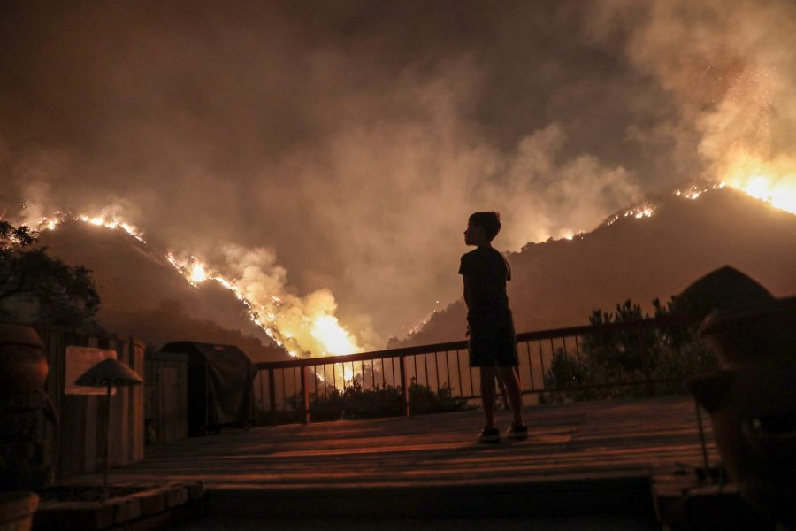 Monrovia, CA, September 15, 2020 - Castle Snider, 8, looks on as flames engulf the hillsides behind his backyard as the Bobcat Fire burns near homes on Oakglade Dr. (Robert Gauthier/ Los Angeles Times/TNS)