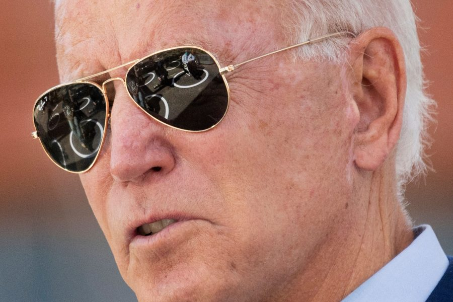 Socially distanced attendees are reflected in Democratic presidential candidate Joe Biden's sunglasses as he speaks at the Black Economic Summit at Camp North End in Charlotte, North Carolina, on Wednesday, Sept. 23, 2020. (Jim Watson/AFP/Getty Images/TNS)