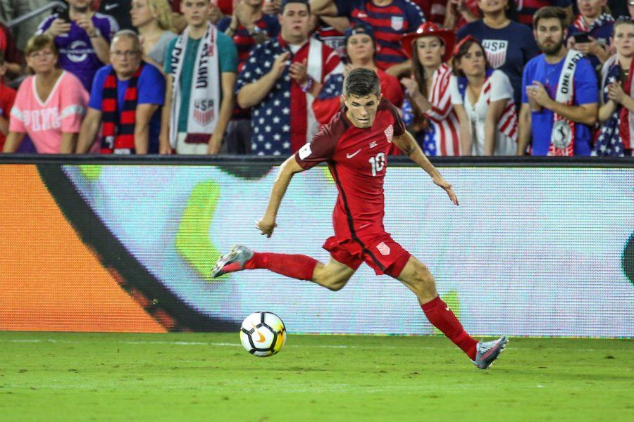 U.S. men's national team star Christian Pulisic (10) keeps his on the eye ball during a match at Exploria Stadium in 2018.