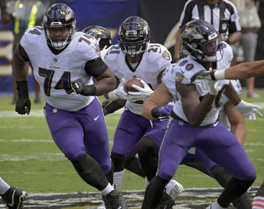 Baltimore Ravens guard Tyre Phillips (74) and wide receiver Miles Boykin (80) make a hole for running back Mark Ingram II (21) to gain first down yardage during the first quarter against the Cleveland Browns on Sunday, September 13, 2020 at M&T Bank Stadium in Baltimore, Maryland. Baltimore prevailed, 38-6. (Karl Merton Ferron/Baltimore Sun/TNS)