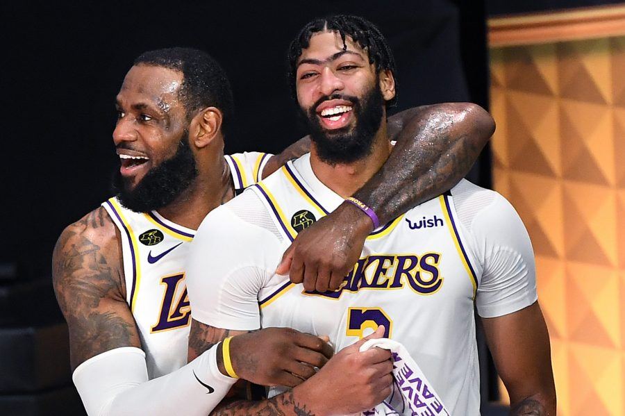 Los Angeles Lakers LeBron James, left, and Anthony Davis celebrate in the closing seconds against the Miami Heat as the Lakers win the NBA Championship in Game 6 of the NBA Finals on Sunday, Oct. 11, 2020 in Orlando, Florida. (Wally Skalij/Los Angeles Times/TNS)