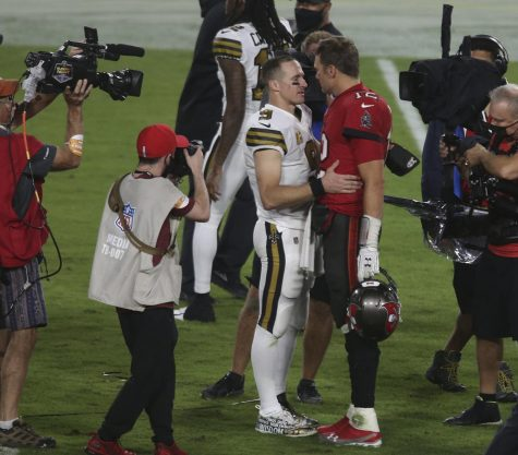 Brady and Brees share a moment Sunday night after the Saint