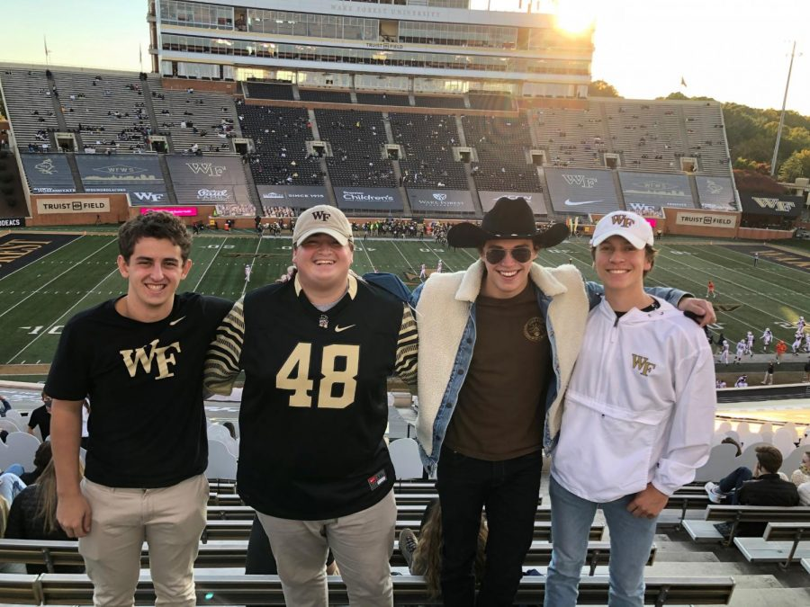 The four friends at the Wake Forest v. UVA football game last month. All that's left of the magical interaction is a hat and a missed connection (Essex Thayer/Old Gold & Black)