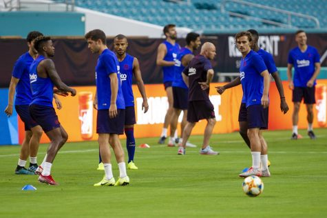 Antoine Griezmann warming up with his teammates before  a pre-season match at Hard Rock Stadium in Miami.