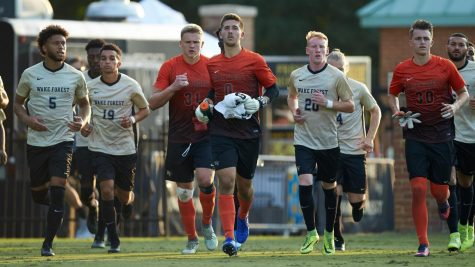 Wake Forest goalie Andrew Pannenberg, who was drafted by Orlando City in this year's MLS Draft, running with McNally.