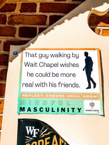 Signs around campus on norms surrounding masculinity are a core part of the campaign.