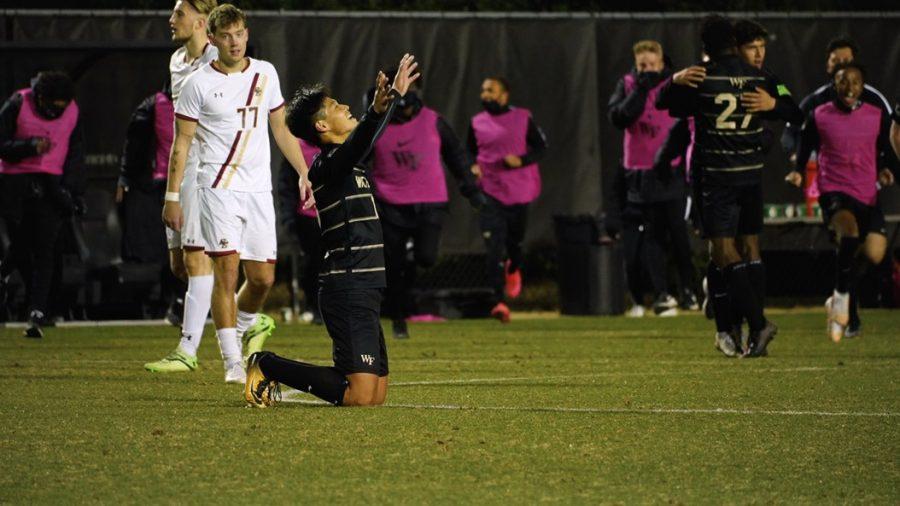 Freshman Hosei Kajima falls to his knees in relief at the final whistle.