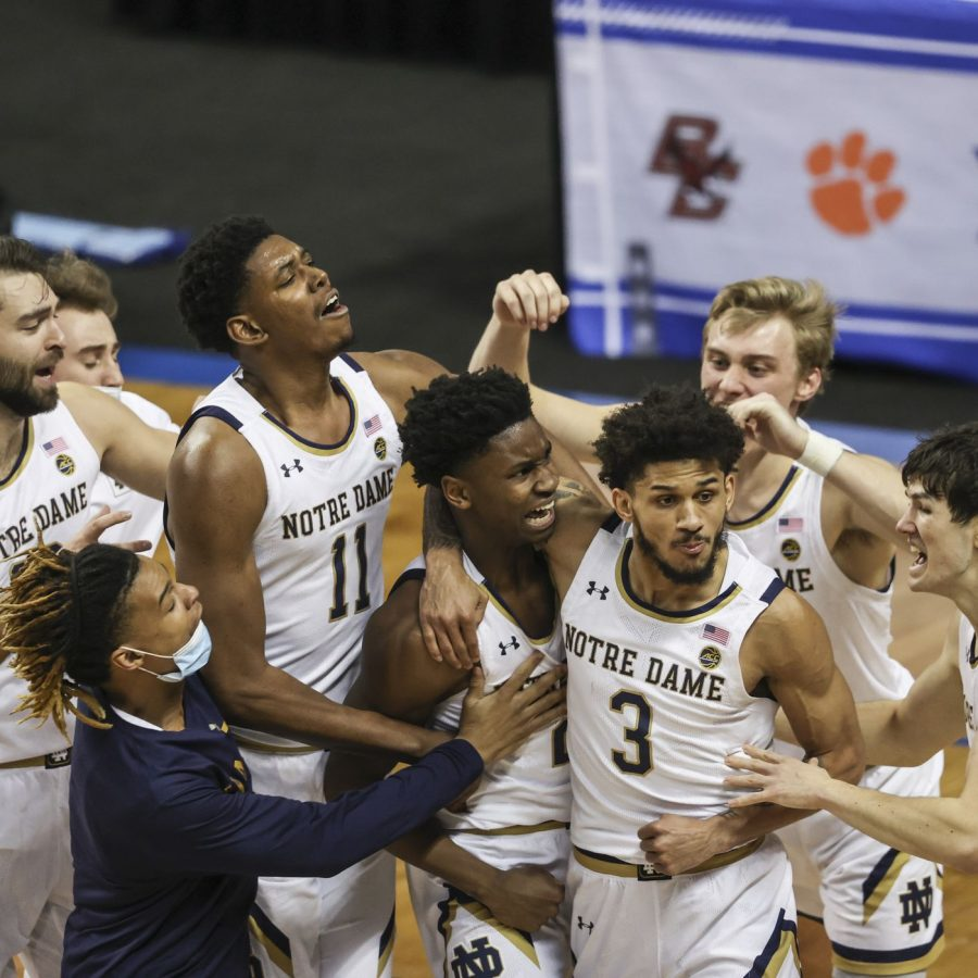 The Notre Dame team surrounded junior guard Trey Wertz in celebration after his buzzer-beating bucket stuns the Demon Deacons.