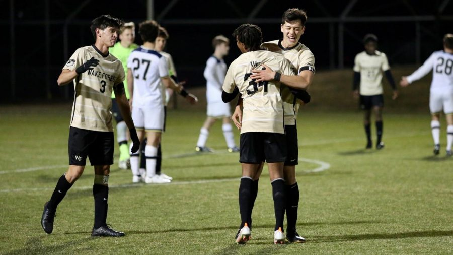 Wake Forest players celebrating Kyle Holcomb's last-minute goal and the team's win against Notre Dame on March 20 in Southbend, IN.