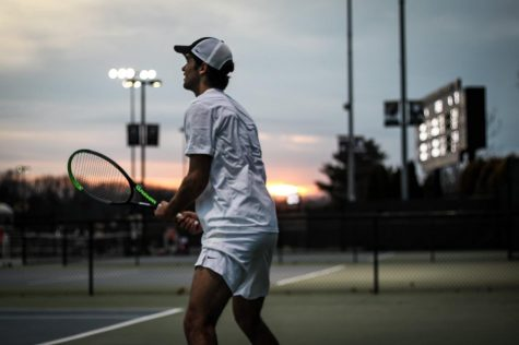 Luciano Tacchi looking off to his teammates' courts during his singles match against the Davidson Wildcats on Feb. 28 at the Wake Forest Tennis Center.