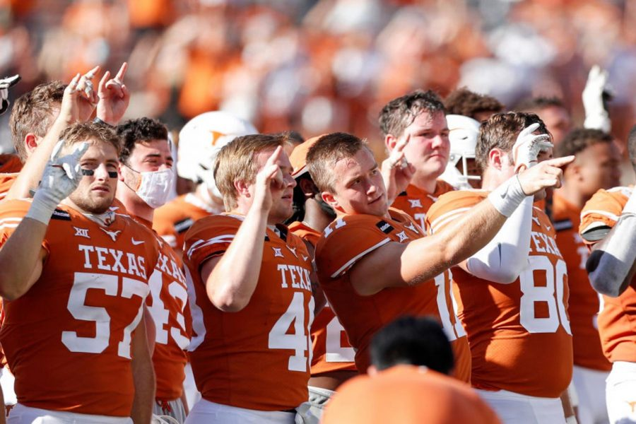 "Texas Longhorns standing for ""The Eyes of Texas"" after a game against the West Virginia Mountaineers on Nov. 7."