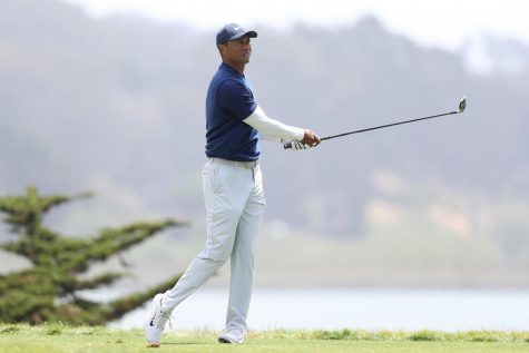 Woods watches his shot at the PGA Championship at TPC Harding in 2020. He will likely be unable to compete in the 2021 edition of the tournament.