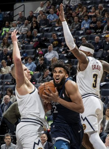 Towns fights through contact for a shot against the Denver Nuggets.