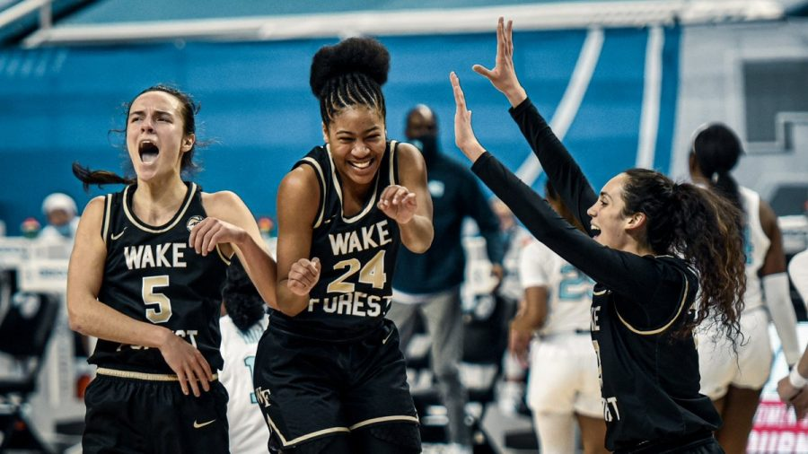 (From left to right) Senior Gina Conti, freshman Jewel Spear and junior Christina Morra celebrate after the  final buzzer. Spear scored 29 points off of seven made three-pointers, an ACC tournament record.