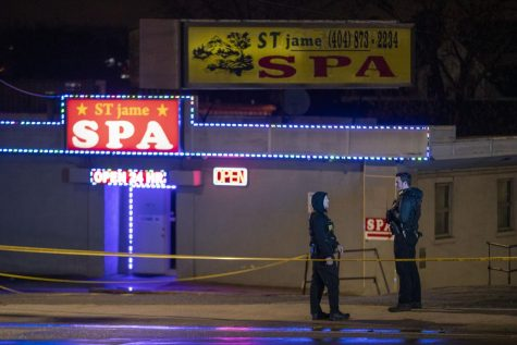 Atlanta police officers and detectives arrive at the Aromatherapy Spa and Gold Spa in Atlanta, one of the three spas targeted on shootings of Tuesday, March 16, 2021.