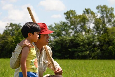 "In this scene from ""Minari"", Jacob (Steven Yeun) and his son David (Alan Kim) embrace and look out at their 50-acre farm in an attempt to divine water."