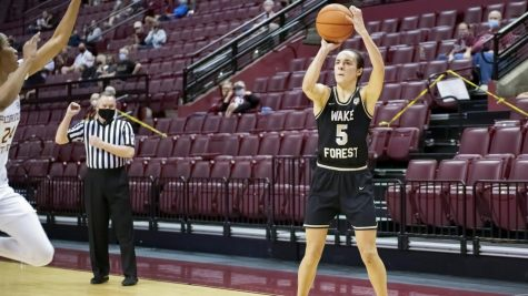 Guard Gina Conti shooting a three-point jumper against Florida State.