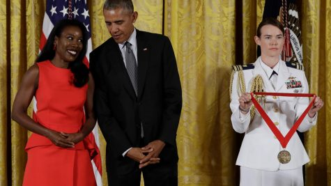 Isabel Wilkerson has won many awards for her writing, including the National Humanities Medal (award ceremony pictured above), which she received from then-President Barack Obama.