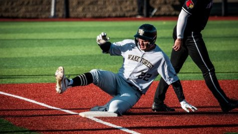 Junior outfielder Michael Ludowig sliding into third base. He hit a home run against Appalachian State on March 30.
