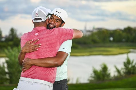 Jon Rahm embraces Finau after his win in the playoff against Cameron Smith. With the third place finish, Rahm moves to second in the rankings.