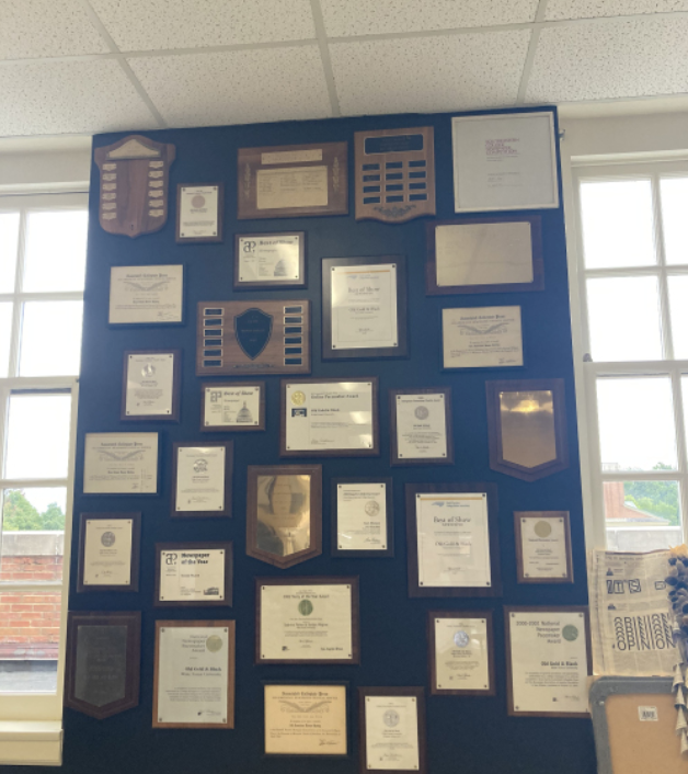 Journalism awards hanging on the walls of the OGB's office.