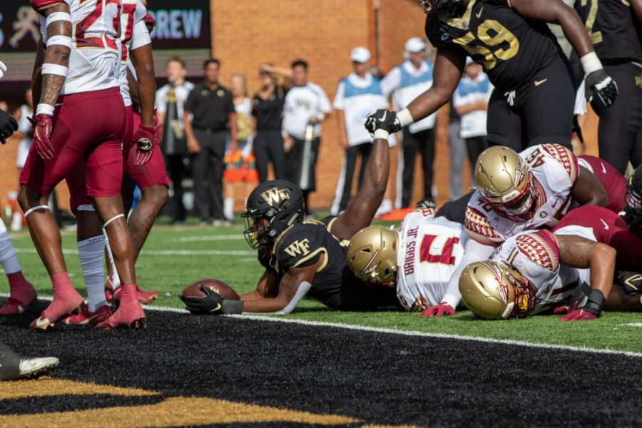 Redshirt+junior+running+back+Christian+Beal-Smith+%2898+rush+yards%2C+one+TD%29dives+into+the+endzone+for+Wake+Forests+second+touchdown+of+the+game.+
