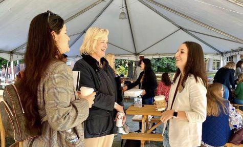 University President Dr. Susan Wente speaks with Student Body President Ally Swartzberg and Senator Pilar Agudelo.