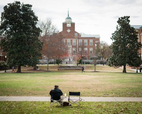 Dr. Hamilton sits in front of Greene Hall overlooking Manchester Plaza while smoking his pipe on an autumn day in 2013. Hamilton passed away from leukemia this past Saturday at the age of 79.