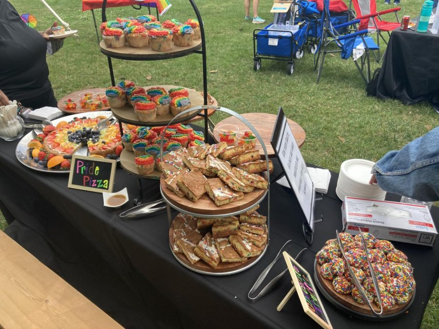 A table at the LGBTQ+ Centers national Coming Out Day celebration on Oct. 11 decked out with rainbow baked goods attracts the attention of passers-by.