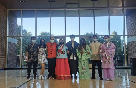Students in traditional attire pose at the harvest festival put on by  the Asian Student Association (A.S.I.A.) on Sept. 26. A.S.I.A. collaborated with many organizations to hold the event.